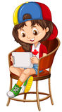 Meisje speelspel op tablet Stock Afbeelding