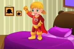 Meisje in superherokostuum Stock Afbeeldingen