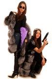 Meisje twee in de bontjassen Royalty-vrije Stock Foto's