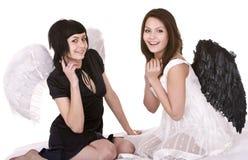 Meisje twee in engelenkostuum. Geïsoleerd. Stock Fotografie