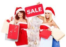 Meisje in van de de hoedenholding van de Kerstman de giftdoos van Kerstmis. Stock Afbeeldingen