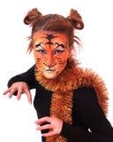 Meisje in verschijning een tijger. Stock Afbeeldingen