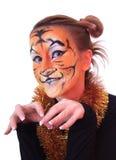 Meisje in verschijning een tijger. Stock Fotografie