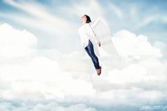 Meisje in wolken Stock Foto
