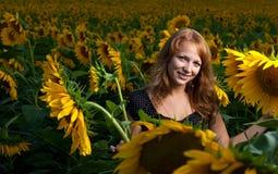 Meisje in zonnebloemen Royalty-vrije Stock Foto