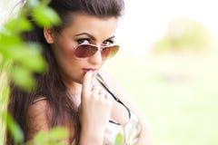 Meisje in zonnebril Stock Foto's