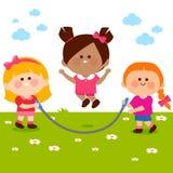 Meisjes die bij het park spelen Stock Afbeelding