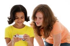 Meisjes die Camera bekijken stock foto's