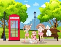 Meisjes en huisdierenhonden in park vector illustratie
