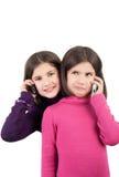 Meisjes en telefoons stock foto