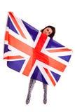Meisjes Engelse die vlag op witte achtergrond Groot-Brittannië wordt geïsoleerd Royalty-vrije Stock Foto