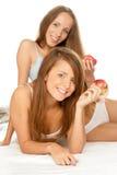 Meisjes met appelen Stock Foto