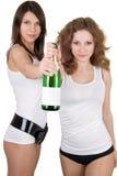 Meisjes met een champagnefles Royalty-vrije Stock Afbeelding