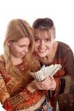 Meisjes met geld in handen royalty-vrije stock foto