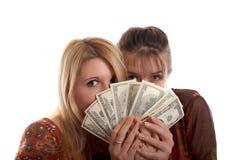 Meisjes met geld in handen royalty-vrije stock fotografie