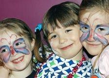 Meisjes met geschilderde gezichten Stock Foto