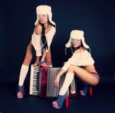 Meisjes met harmonika stock fotografie