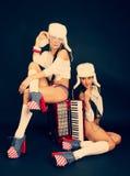 Meisjes met harmonika stock foto