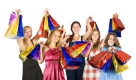 Meisjes met het winkelen zakken stock fotografie