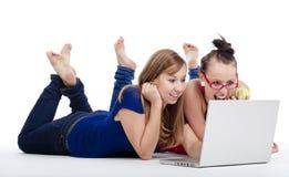 Meisjes met laptop Stock Afbeelding