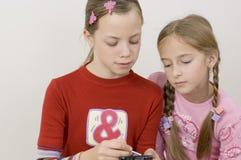 Meisjes/palmtop stock afbeelding