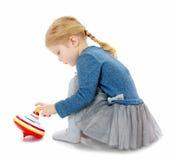 Meisjes speelbromtol Stock Foto