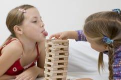Meisjes/spel/wit stock afbeeldingen