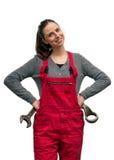 Meisjesarbeider met moersleutel Stock Foto