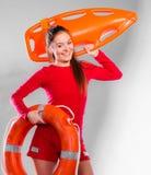 Meisjesbadmeester met reddingsmateriaal Royalty-vrije Stock Afbeelding