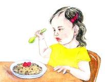 Meisjeskind die havermoutpap met frambozen eten Royalty-vrije Stock Foto