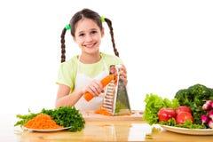 Meisjesrooster de wortelen Stock Foto
