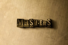 MEISTER - Nahaufnahme des grungy Weinlese gesetzten Wortes auf Metallhintergrund Lizenzfreies Stockbild