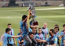 Meisterschaftfeiern von APOEL schlagen, ZYPERN mit einer Keule Lizenzfreie Stockfotos
