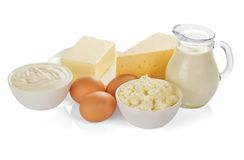 Mejeriprodukterna som isoleras på vit arkivfoto
