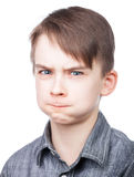 Mejillas que soplan del muchacho Fotografía de archivo