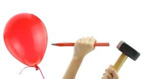 Mejsla och bulta omkring för att poppa en ballong royaltyfri foto