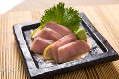 Mekajiki (Swordfish) Sashimi. Thin slices of swordfish sashimi on a stone plate stock photography
