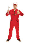 Mekaniker i röd overall royaltyfri foto