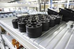 Mekaniska kugghjul i metall i lagerhus Fotografering för Bildbyråer