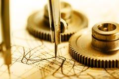 Mekaniska spärrhjular och skissning royaltyfri foto