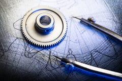 Mekaniska spärrhjular och skissning arkivbilder