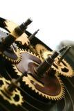 mekaniskt klockakugghjul arkivfoton