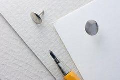 Mekaniskt rita och häftstiftet arkivbild