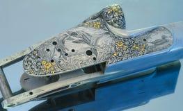 Mekanism av gravyren på tillverka för vapen arkivfoto