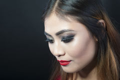 Make-up. Indian girl with make-up. Black beckground Royalty Free Stock Photography