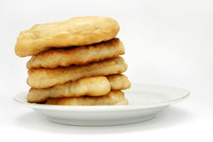 Mekitsi. Mekitsa (or mekica): batter fried in deep oil. In dish Stock Photos