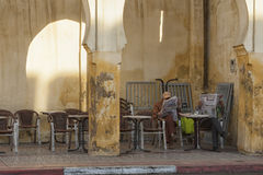 MEKNES, MOROCCO - FEBRUARY 18, 2017: Unidentified men sitting in a cafe in the street of Meknes, Morocco. Meknes is one of the four Imperial cities of Morocco Royalty Free Stock Photography