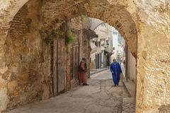 MEKNES, MOROCCO - FEBRUARY 18, 2017: Unidentified people walking in the street of Meknes, Morocco. Meknes is one of the four Imper. Ial cities of Morocco Stock Photos