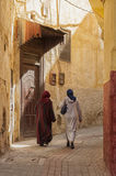 MEKNES, MOROCCO - FEBRUARY 18, 2017: Unidentified women walking in the street of Meknes, Morocco. Meknes is one of the four Imper. Ial cities of Morocco Royalty Free Stock Photography