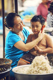 MEKONG DELTA - JUNE 14: Unidentified kid in a market with his mo Royalty Free Stock Images
